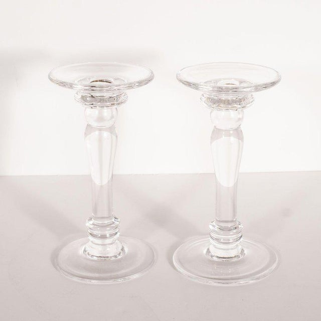 This elegant pair of Mid-Century Modern candlesticks was realized in the United States, circa 1960. Modeled after the...