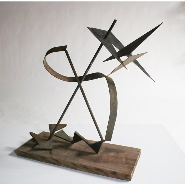 One-of-a kind brustalist metal sculpture in the style of Calder shows an original patina and rests on a wood plinth....