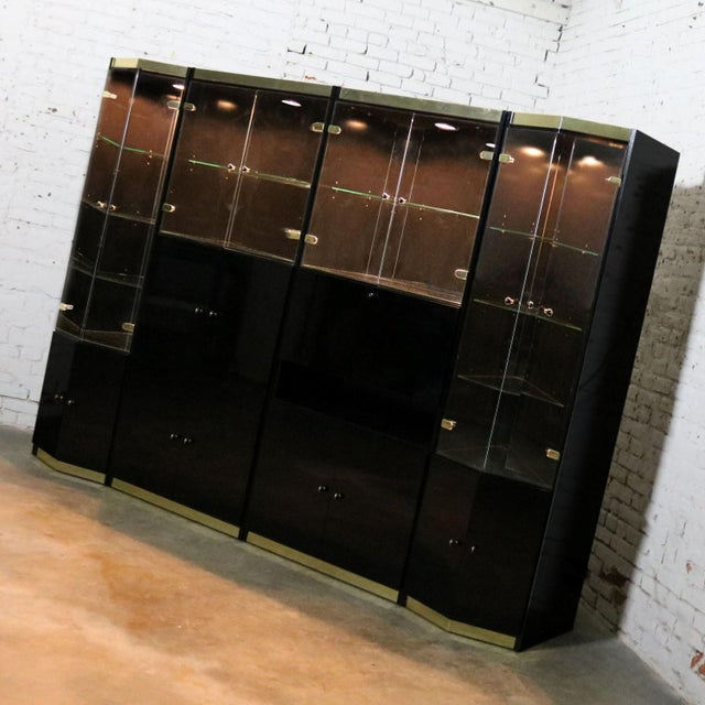 Impressive Italian four-piece modular freestanding wall unit bookcase display cabinet in black laminate with glass doors...