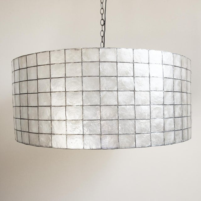 Capiz shell drum lantern. A unique, contemporary lantern that will look beautiful in any interior.