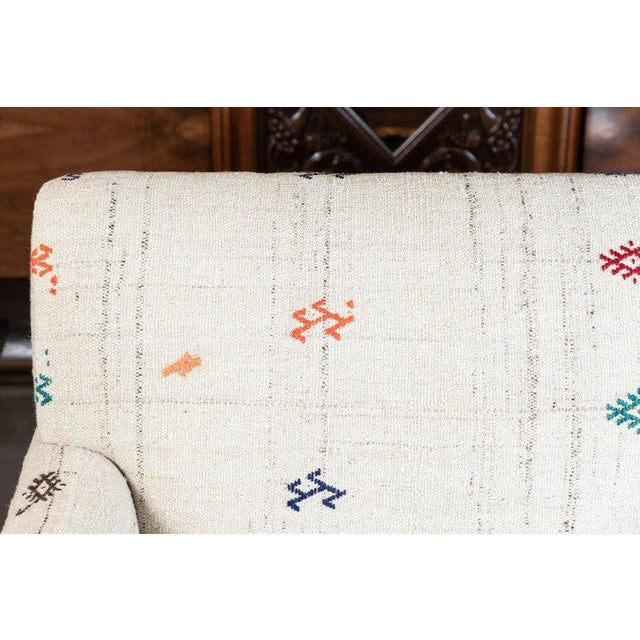 Custom-made 5' settee, upholstered in a vintage flat-weave Kilim rug from Turkey and finished with a nailhead trim.