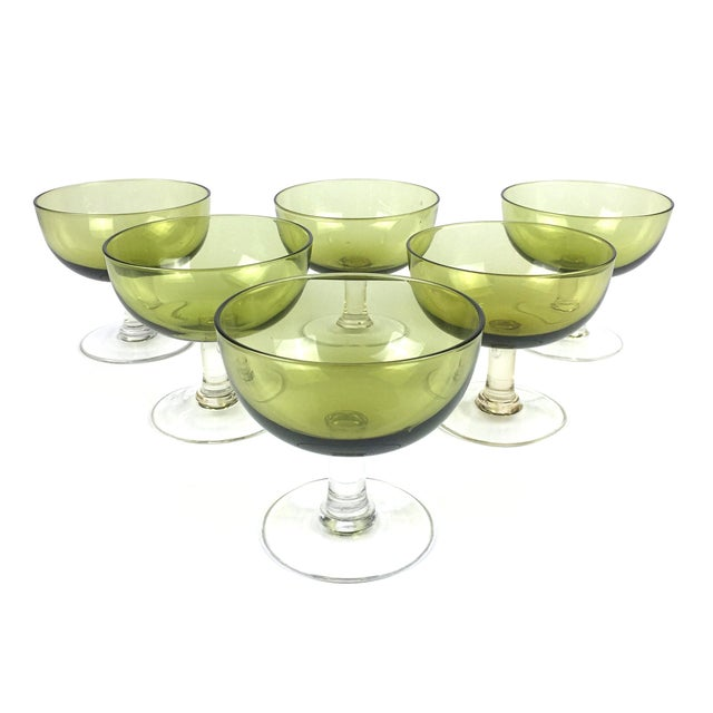 Drink champagne and dance on the tables with these cheerful green coupes. This set of 6 glasses mid century glasses could...