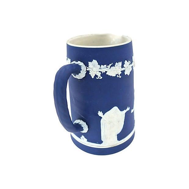 Antique Adams Jasper dip glaze jug. Raised relief pattern. Maker's mark on underside.