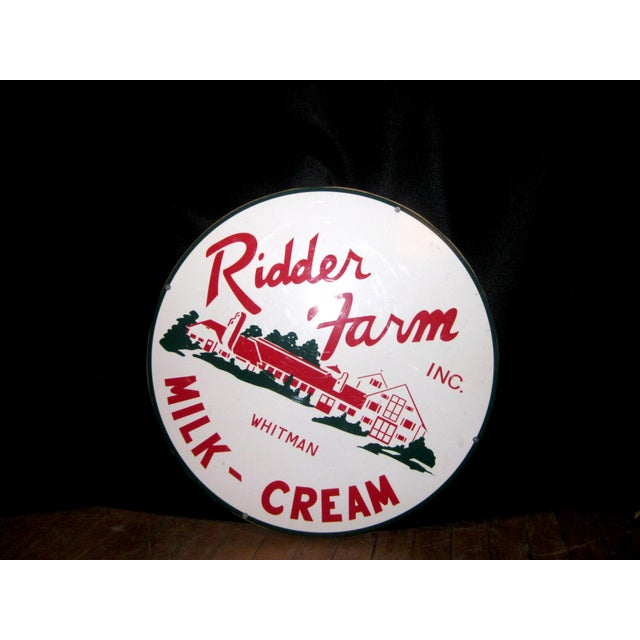 This is a vintage-style (made in ~1980s) advertisement sign made of porcelain on a wooden backing. It promotes a dairy...