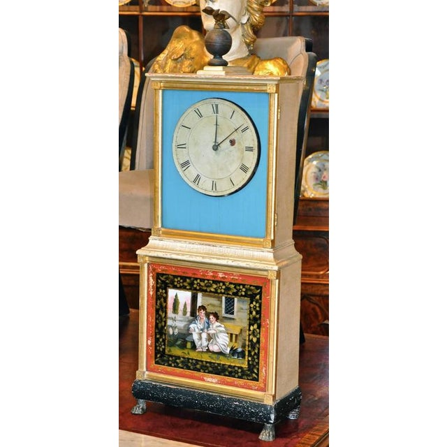 This listing is for a rare Aaron Willard Federal églomisé bride's clock. Attractive shelf clocks of this form were...