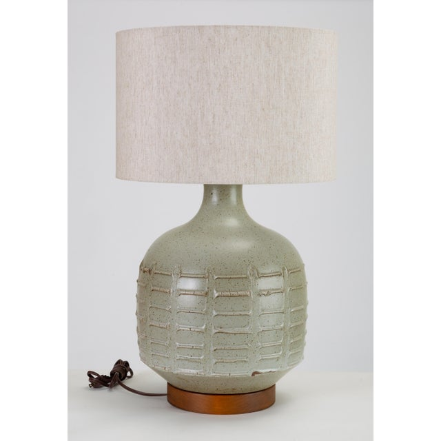 A gray-glazed ceramic table lamp designed by David Cressey for Architectural Pottery's 1960s Pro/Artisan Collection. The...