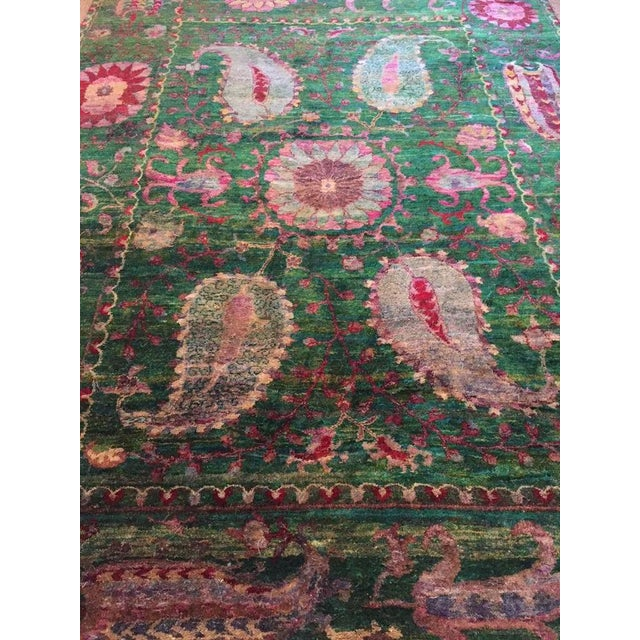 Sari silk rug. A one of a kind, hand knotted rug produced using recycled sari silk yarn. In silk rugs, the color moves...