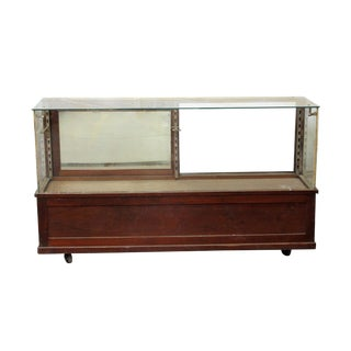 20th Century Early American Wooden Glass Front Showcase on Wheels For Sale