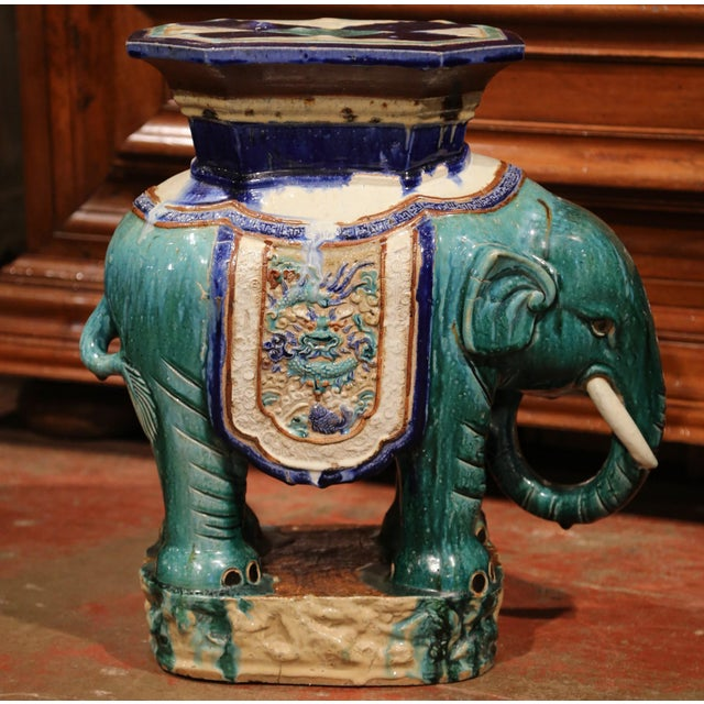 This colorful porcelain garden seat was sculpted in France, circa 1920. The shaped elephant features heavy decorated...