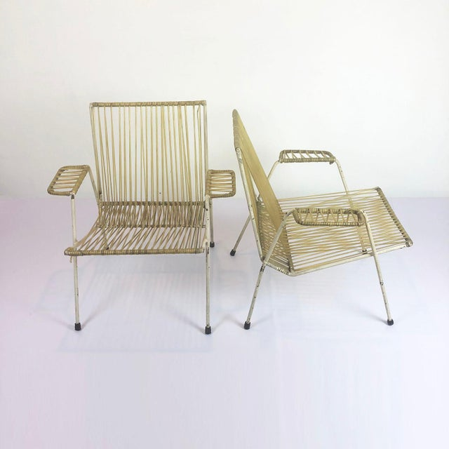 We offer these pair of amazing and vintage armchairs in the style off the designs of Clara Porset, circa 1960.