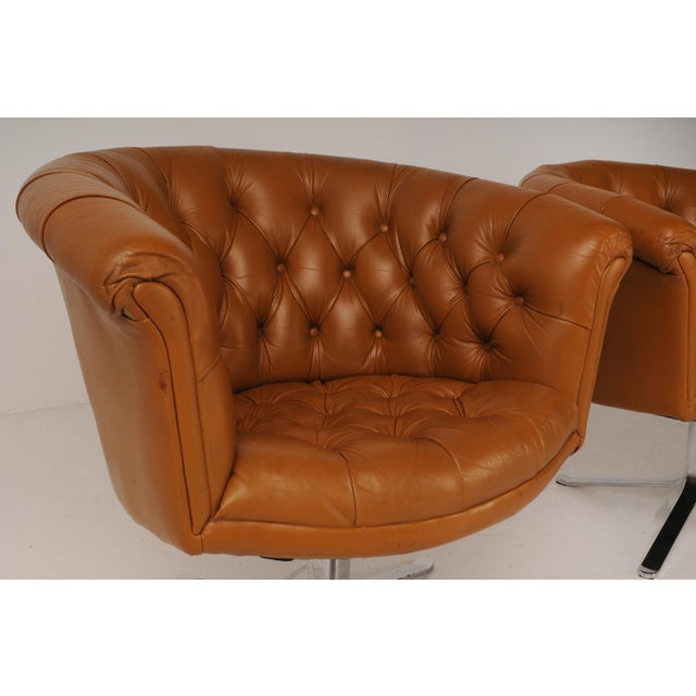 Sexy swivel chairs in carmel leather by noted industrial designer Nicos Zographos, who created a vast catalogue of luxe,...