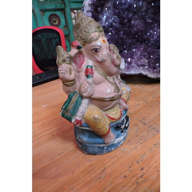 Ganesh is the Remover of Obstacles. This 20th Century terra cotta figurine would sit on your shelf or desk and be the...