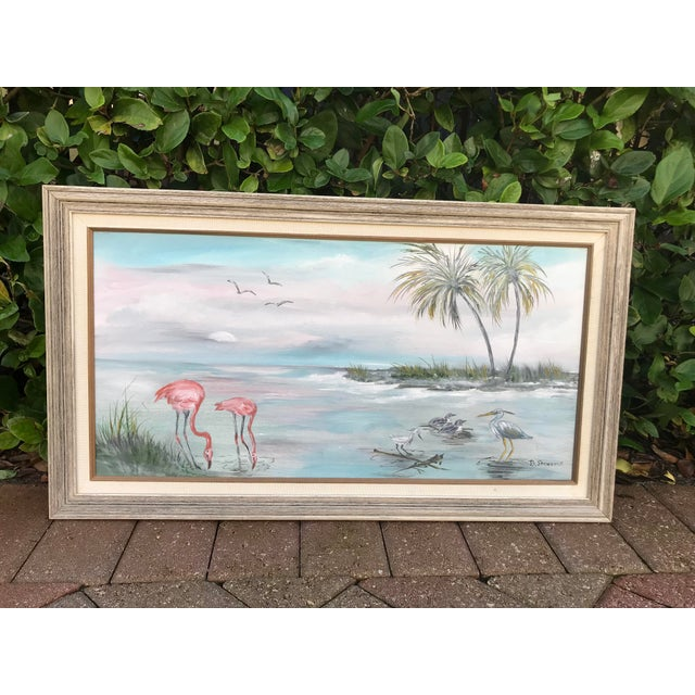 """Vintage original """"Old Florida"""" style painting. Shoreline scene with flamingos and palms. Nicely framed and in good vintage..."""