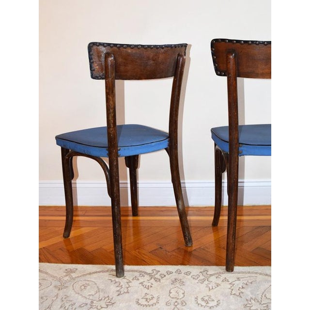 A set of three original Thonet bentwood chairs produced in The Czech Republic. All three are in unaltered condition and...