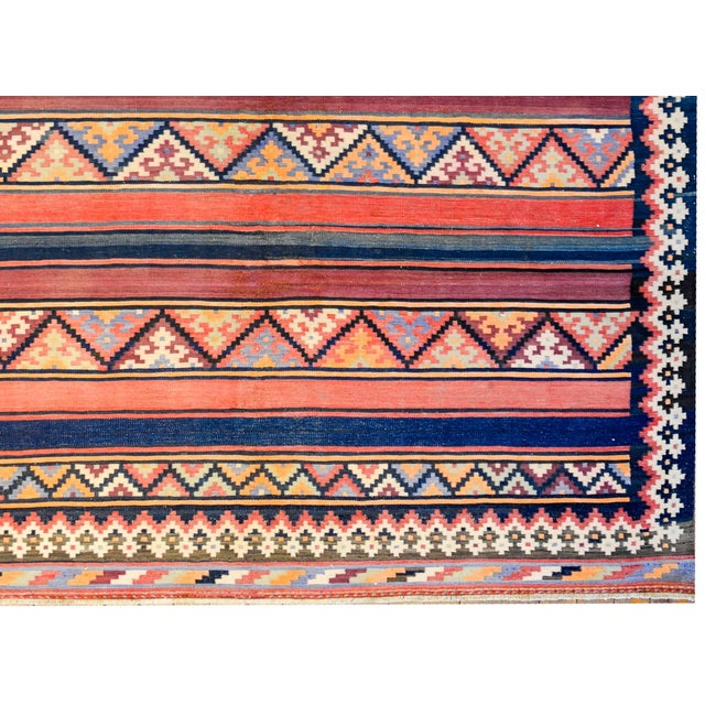 A beautiful early 20th century Persian Zarand Kilim runner with a fantastic pattern of alternating boldly multicolored...