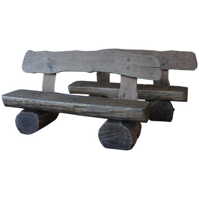 Pair of rustic solid oak benches made in France in the 1960s. The pair have been lightly refinished and still show a...