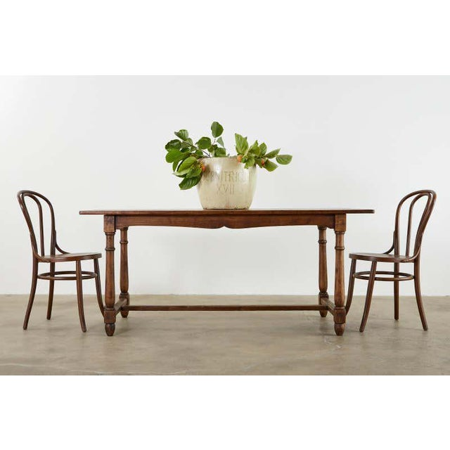 Rustic Country English Provincial style farmhouse dining table. handcrafted from oak having a plank top and an exposed...