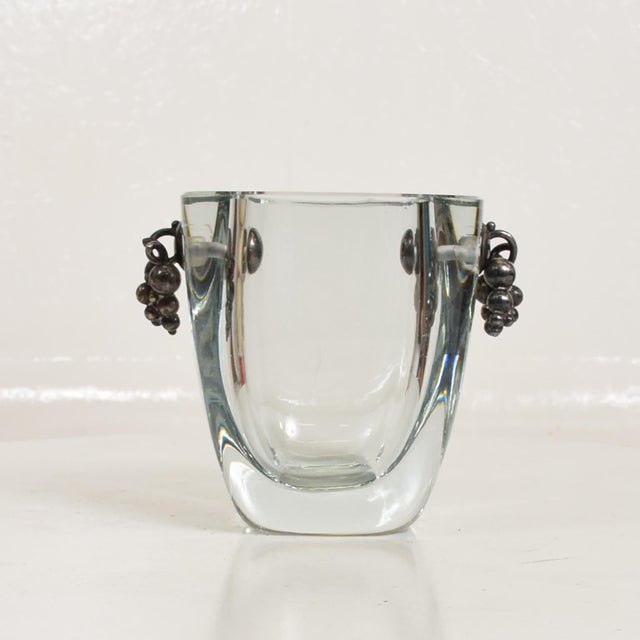 For your consideration, a Beautiful Thick Glass Vase With Silver Grapevine Accents. Silver grapevine has a signature from...