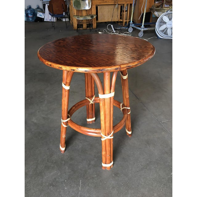 """Small """"Double Circle"""" rattan side table with 24"""" round Mahogany top and decorative second tier Ring. The table features..."""