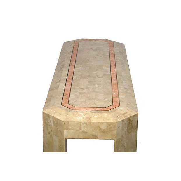Console hallway or sofa table in tessellated bone with beveled edges, and inlaid brass trim border. This piece adds...