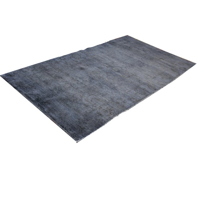 This beautiful rug is a fine example of an overdyed area rug, the design is originally from Turkey but reproduced in...