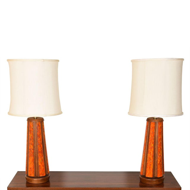 Large, stunning pair of mixed material lamps! Walnut ribs have mottled orange enamel sections all around. These will be...