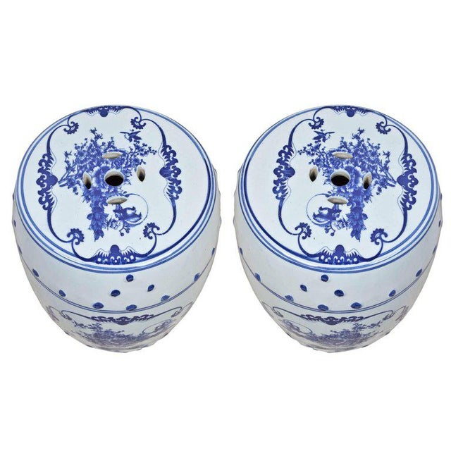 Pair of blue and white Chinese porcelain garden seats or side tables with floral motif, mid-1900s. Excellent condition.