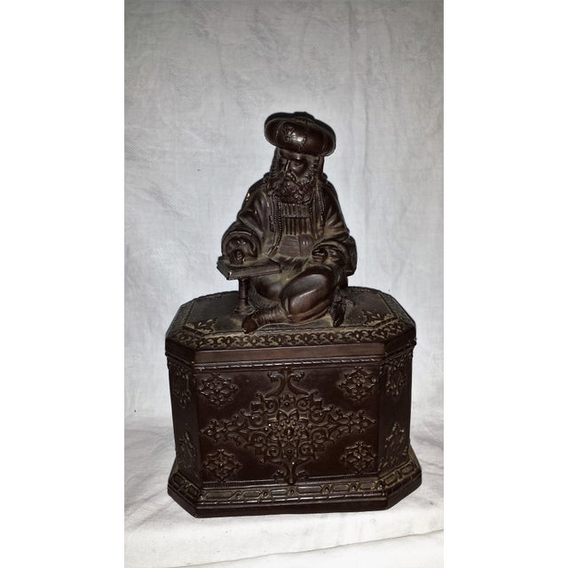 Figural Scribe pottery. Highly detailed scribe sitting on top of jar lid. Beautiful decorations on jar as well. by...