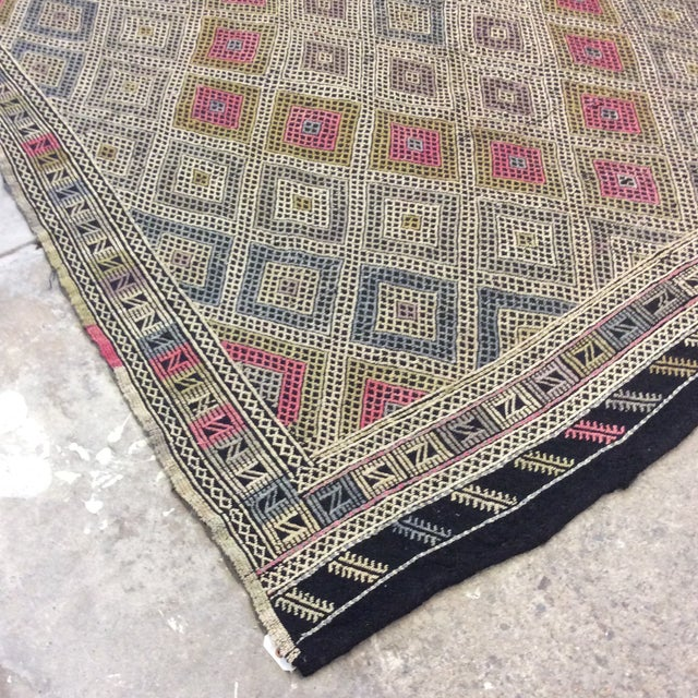 It's time to get on the Kilim kick! This is a great almost square shape which is very had to find. Pinks,, chartreuse,...