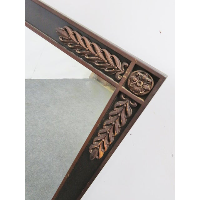 A pair of Ebonized and gold painted mirror in the Jansen style Made by Kittinger