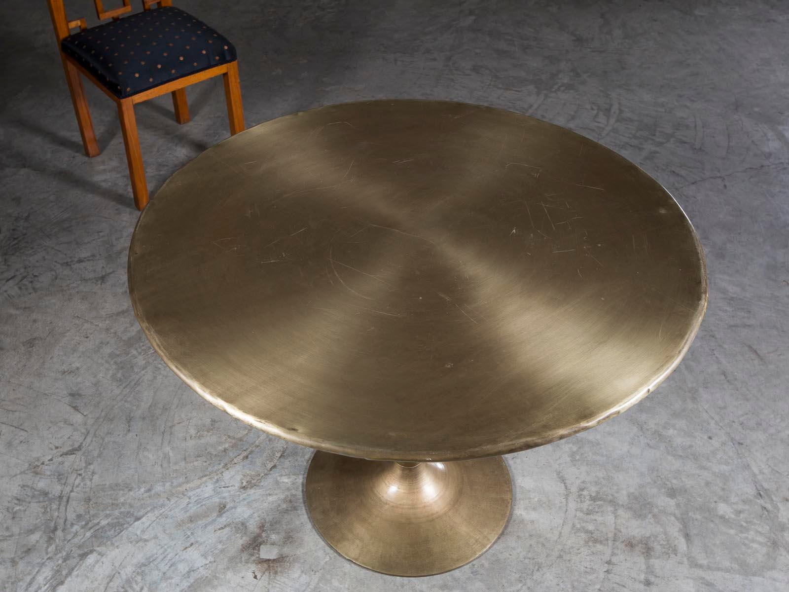 A Striking Round Brass Saarinen Style Dining Table From Holland. The  Elegant Restraint Exercised By
