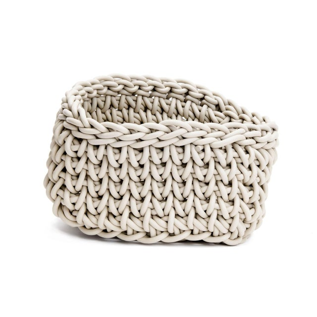 Ecru Quadrato Basket By Neo Hand-knit in Italy, this neoprene basket is designed by Rosanna Contadini. Neoprene is strong...