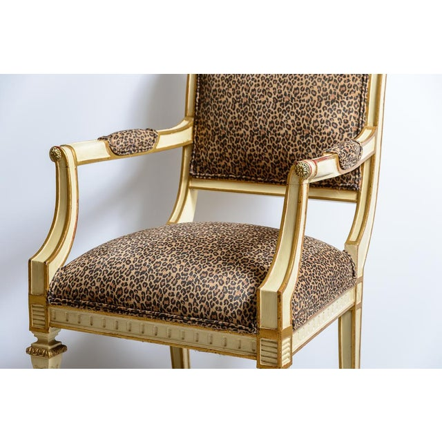 Pair of leopard upholstered fauteuil chairs. Louis Sixteenth style painted cream wit gold accents.
