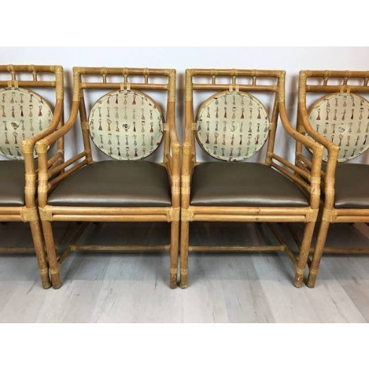 Hollywood Regency Vintage McGuire Style Rattan Arm Chairs With Rawhide Strapping - Set of 4 For Sale - Image 3 of 4
