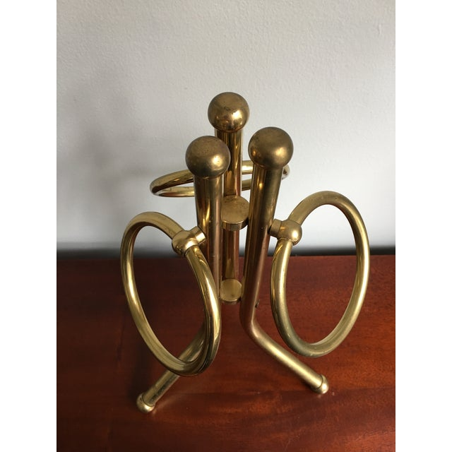 Mid-Century brass standing hand towel holder, with three adjustable rings to use for each towel/linen.