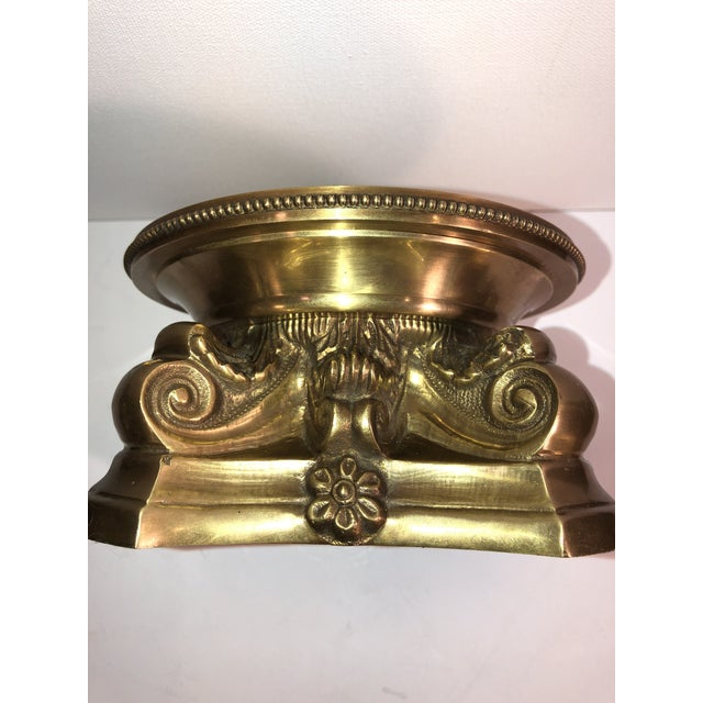 This is a very heavy antique solid brass piece that you can set a candle directly on or use a large glass hurricane on...