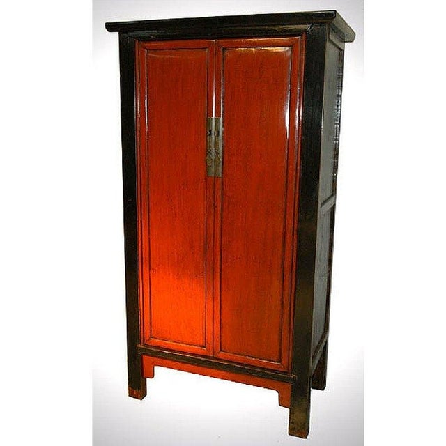 Elegantly framed in black, this circa 1900 red lacquer armoire is simply an exceptional piece on all fronts. Traditional...