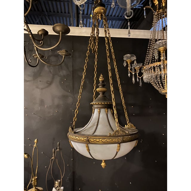 A 1900 Caldwell light fixture with interior lights