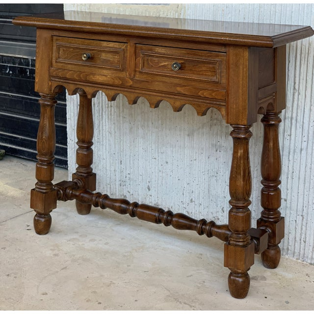 About 19th Spanish walnut console table with two drawers. Details IN THE STYLE OF Spanish Colonial PLACE OF ORIGIN Spain...