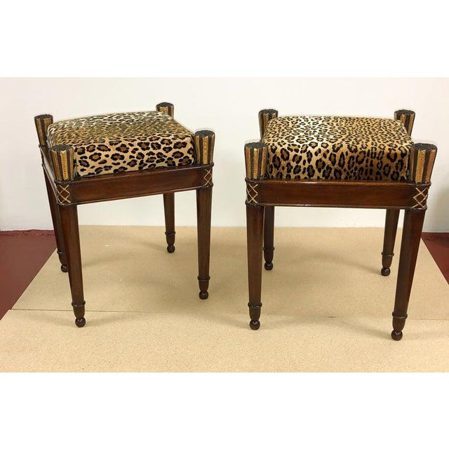 A fine pair of French Directoire mahogany stools with crushed velvet Leopard upholstery, a square mahogany frame with...