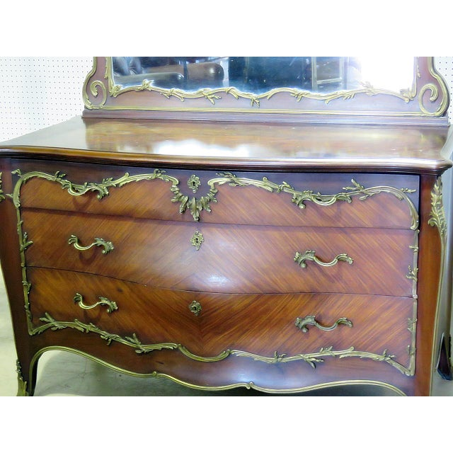 "Regency style 3 drawer commode with mirror and bronze mounts. The commode measures 34""h x 54""w x 23""d. The mirror measures..."