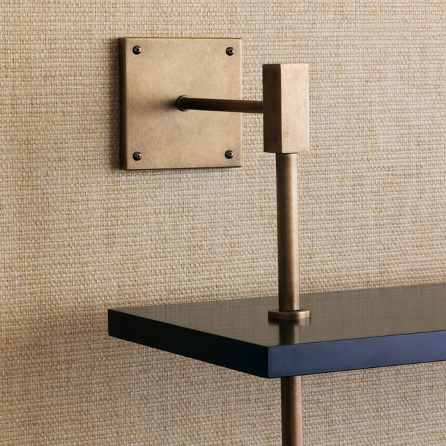 Port 68 Modern multi-tier shelf in aged brass and black, details urban simplicity with burnished finishes. As shown,...