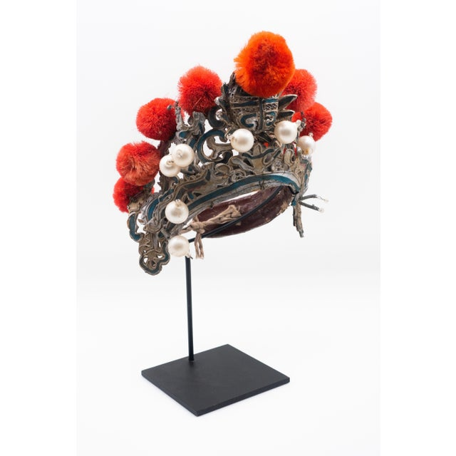 Chinese opera theatre headdress in turquoise with coral colored pom poms along with faux pearls, early 20th century,...