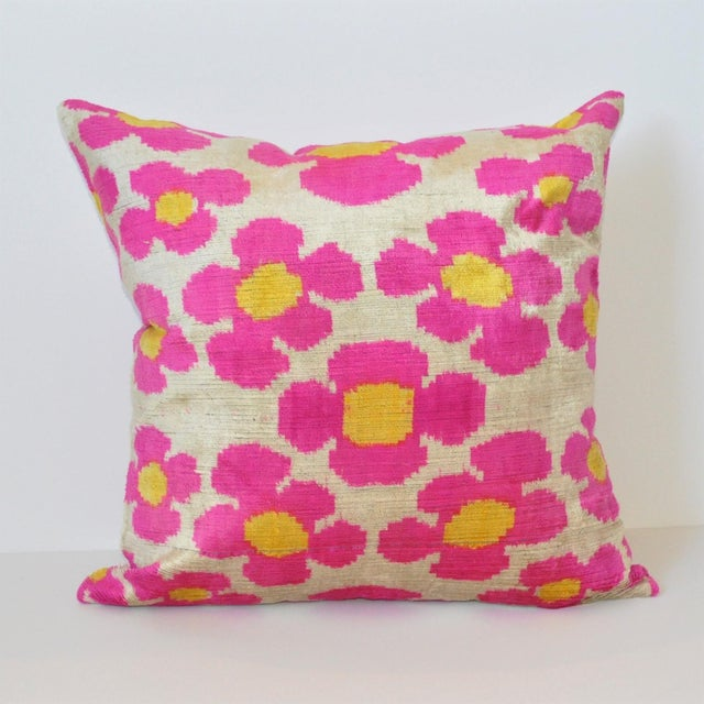 Whimsical Silk Velvet throw pillow with a patterned ikat fabric for the back. Pillow has a hidden zipper for closure. A...