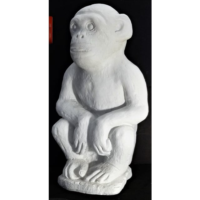 Offering a vintage monkey sculpture made out of cement and recently painted white. You can see from the bottom photo the...