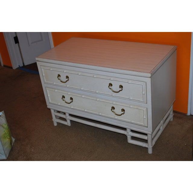 Matching set of vintage Ficks Reed nightstands in great vintage condition. Faux bamboo and rattan style with brass...