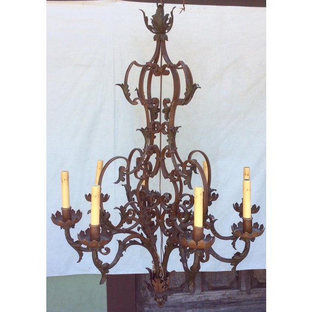 "Great looking highly detailed iron Chandelier circa 1920. Great look for a Tuscan or French Country estate. 58"". With..."