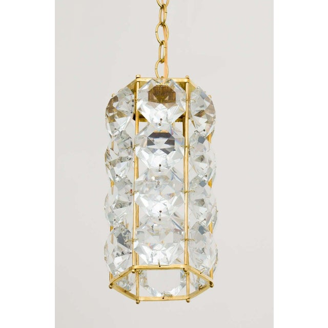 Pair of German 1960s hexagonal faceted crystal chandeliers with gilt brass frame. Frame measures 13.5 inches height x 6.5...