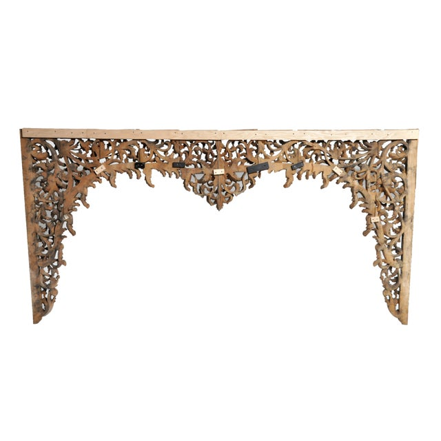 This hand carved Burmese arch was made from Teak wood. This impressive decoration features vine and floral motifs and were...