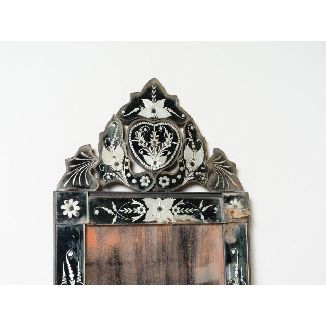 Antique Venetian mirror with etched flora filigree around glass frame. Italy circa 1880.